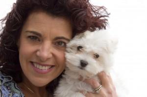 woman and bichon dog